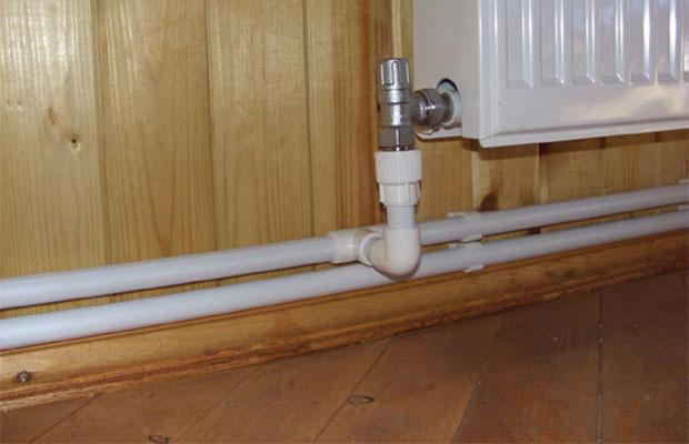 Двухтрубная система отопления идеально подойдет для контура с принудительным движением теплоносителя